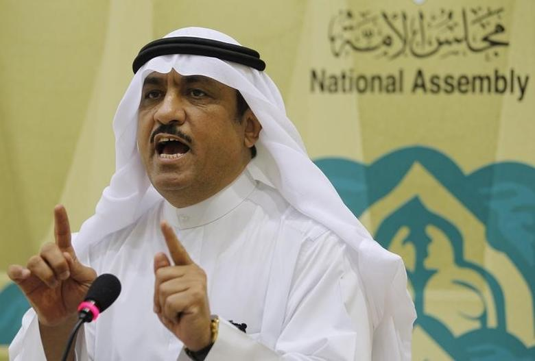 Kuwaiti lawmaker Musallam al-Barrak gestures while speaking to journalists at Parliament's media center in Kuwait City November 20, 2011. REUTERS/Hamad I Mohammed