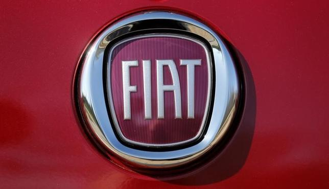 The Fiat logo is seen on a Fiat vehicle displayed outside Chrysler World Headquarters during the FCA Investors Day in Auburn Hills, Michigan May 6, 2014.  REUTERS/Rebecca Cook