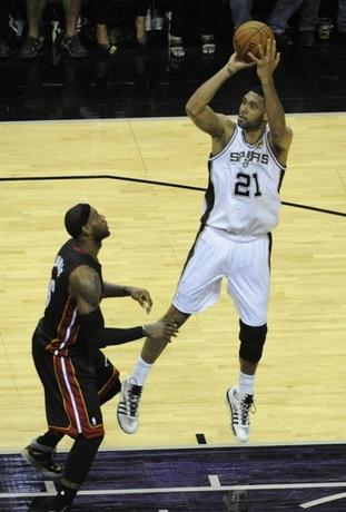 San Antonio Spurs forward Tim Duncan (21) shoots against Miami Heat forward LeBron James (6) in game five of the 2014 NBA Finals at AT&T Center. Jun 15, 2014, Brendan Maloney-USA TODAY Sports