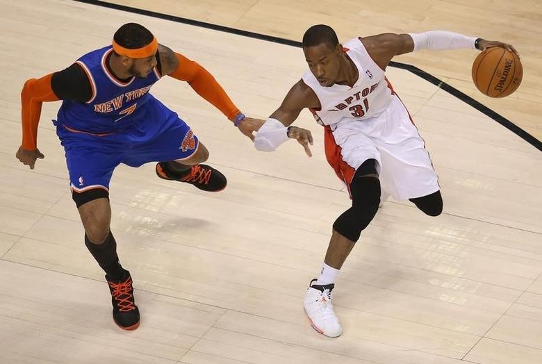 Toronto Raptors guard Terrence Ross (31) dribbles against New York Knicks forward Carmelo Anthony (7) at Air Canada Centre. Apr 11, 2014; Tom Szczerbowski-USA TODAY Sports