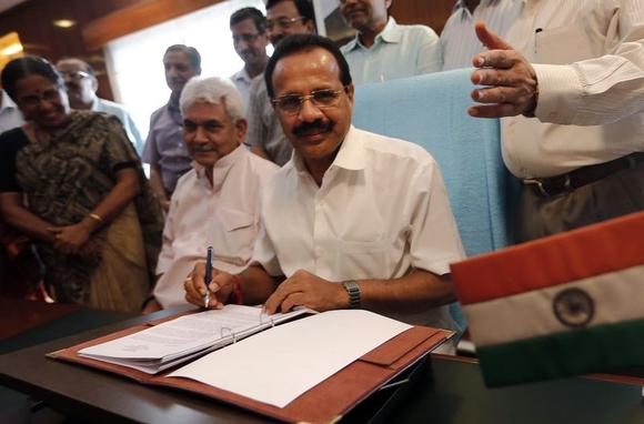 Railway Minister Sadananda Gowda (C) poses after giving the final touches to the railway budget for the 2014/15 fiscal year, in New Delhi July 7, 2014. REUTERS/Adnan Abidi
