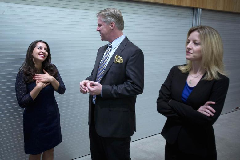 (L-R) Actors Natalie Gallo as former White House intern Monica Lewinsky, Karl Kenzler as former U.S. President Bill Clinton and Alet Taylor as former first lady and Democratic presidential front-runner Hillary Clinton practice a piece from 'Clinton: The Musical' in the hallway before the New York Musical Theatre Festival  preview in New York July 2, 2014.       REUTERS/Carlo Allegri