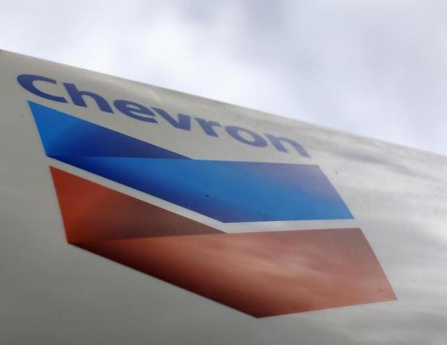 A Chevron gas station sign is pictured at one of their retain gas stations in Cardiff, California October 9, 2013. REUTERS/Mike Blake