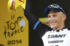 Giant-Shimano team rider Marcel Kittel of Germany celebrates on the podium after winning the 155 km third stage of the Tour de France cycling race from Cambridge to London July 7, 2014           REUTERS/Jean-Paul Pelissier