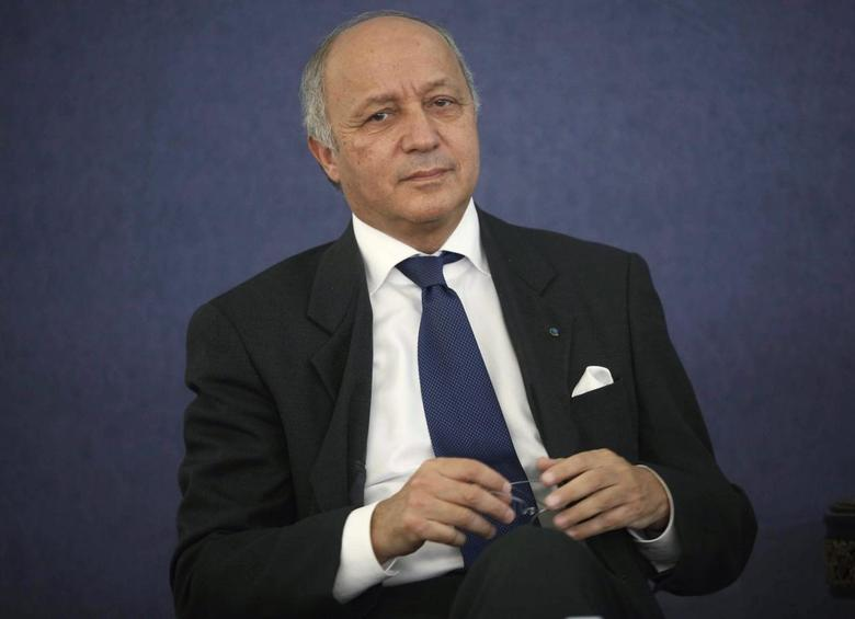 France's Foreign Minister Laurent Fabius looks on as he listens to Algeria's Industry Minister Abdeslam Bouchouareb's (unseen) speech in Algiers June 9, 2014. REUTERS/Ramzi Boudina