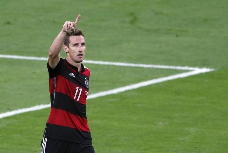 Germany's Miroslav Klose celebrates after scoring his team's second goal against Brazil during their 2014 World Cup semi-finals at the Mineirao stadium in Belo Horizonte July 8, 2014. REUTERS/David Gray