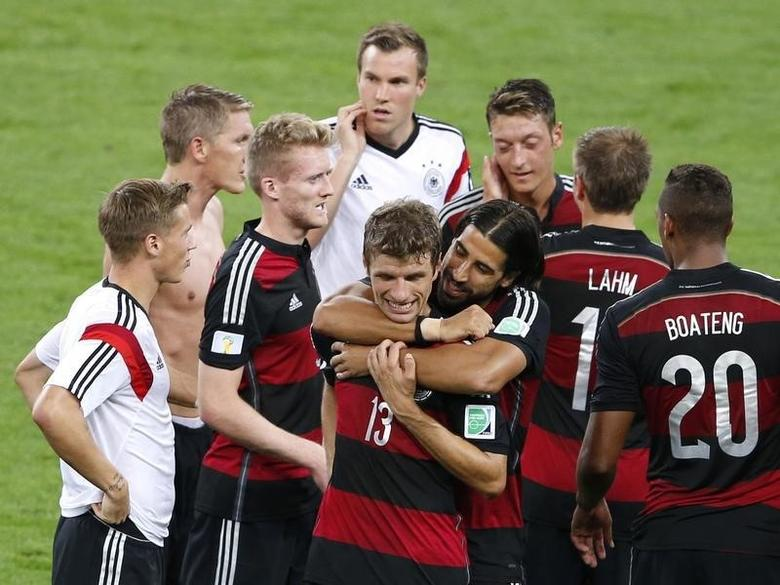 Germany's players celebrate after winning their 2014 World Cup semi-finals against Brazil at the Mineirao stadium in Belo Horizonte July 8, 2014. REUTERS/David Gray
