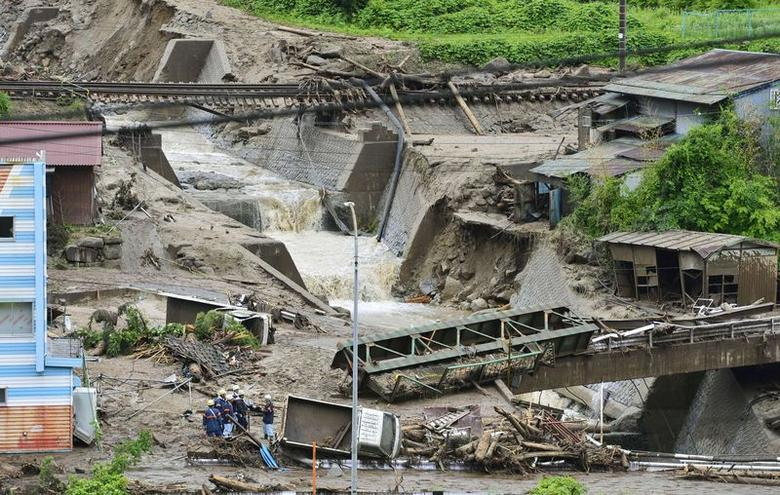 Damaged cars and buildings are seen after a landslide caused by heavy rains due to Typhoon Neoguri in Nagiso town, Nagano prefecture, in this photo taken by Kyodo July 10, 2014. REUTERS/Kyodo