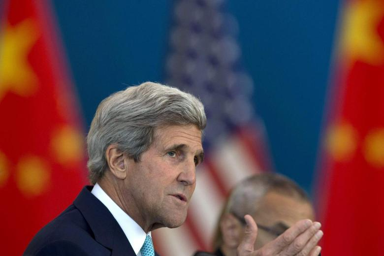 U.S. Secretary of State John Kerry speaks at a Strategic Dialogue expanded meeting with Chinese officials during the U.S.-China Strategic and Economic Dialogue held at the Diaoyutai State Guesthouse in Beijing July 10, 2014.  REUTERS/Ng Han Guan/Pool