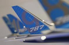 The tailwing of a model Boeing 787 Dreamliner aircraft is pictured at the Boeing booth at the Singapore Airshow February 11, 2014.   REUTERS/Edgar Su