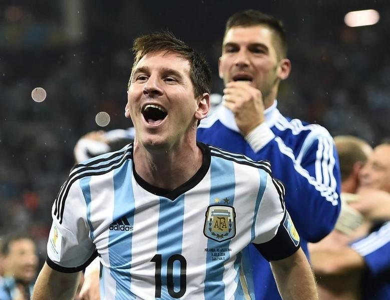 Argentina's Lionel Messi celebrates with teammate Mariano Andujar (back) their win over the Netherlands at the end of their 2014 World Cup semi-finals at the Corinthians arena in Sao Paulo July 9, 2014. REUTERS/Dylan Martinez