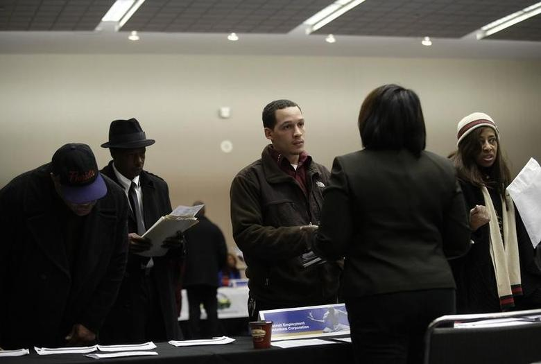 People attend a job fair in Detroit, Michigan March 1, 2014. REUTERS/Joshua Lott