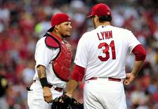 St. Louis Cardinals catcher Yadier Molina (4) talks with starting pitcher Lance Lynn (31) during the second inning against the Pittsburgh Pirates at Busch Stadium. Jul 9, 2014; St. Louis, MO, USA;  Jeff Curry-USA TODAY Sports