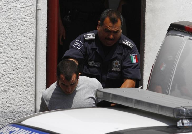 Andrew Tahmooressi is escorted out of a court house in Tijuana May 28, 2014 file photo. REUTERS/Jorge Duenes