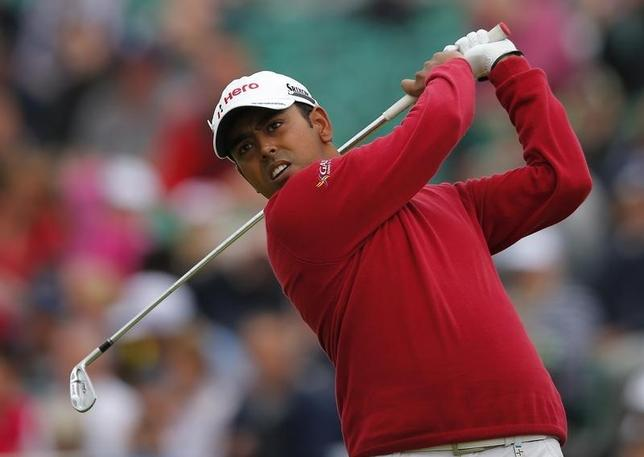 Anirban Lahiri of India watches his tee shot on the fifth hole during the second round of the British Open golf championship at Royal Lytham & St Annes, northern England July 20, 2012.  REUTERS/Brian Snyder/Files
