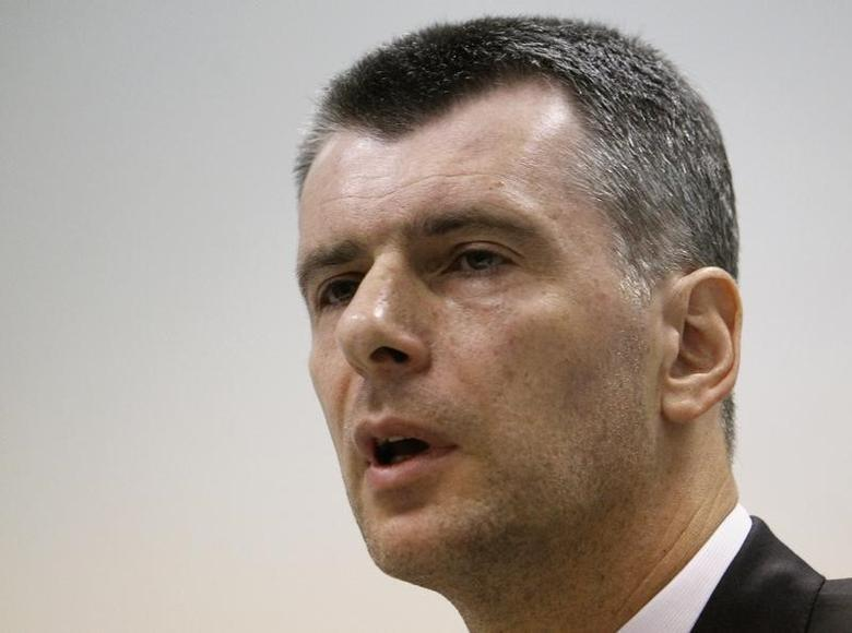 Russian billionaire Mikhail Prokhorov speaks during a news conference, dedicated to addressing issues in the upcoming Moscow mayoral elections, in Moscow June 13, 2013.  REUTERS/Sergei Karpukhin