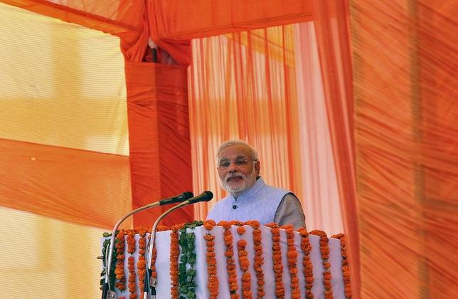 Indian Prime Minister Narendra Modi addresses during a gathering after inaugurating a train on a new stretch of railway to the town of Katra, northwest of Jammu July 4, 2014. REUTERS/Mukesh Gupta