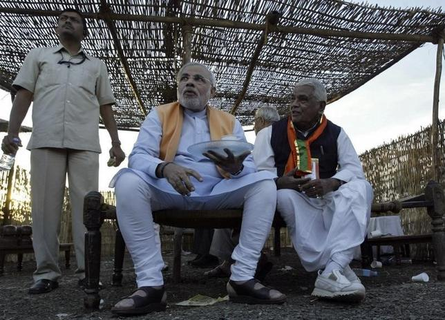 Lawmaker Babulal Gaur (R) sits with then Gujarat chief minister Narendra Modi in the central Indian city of Indore in this February 17, 2010 picture. REUTERS/Raj Patidar