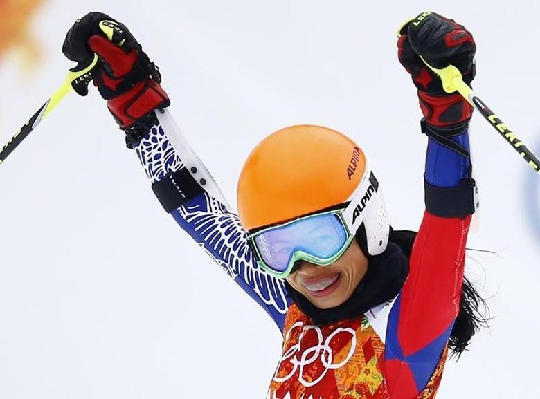 Vanessa Mae, competing for Thailand under her father's name Vanessa Vanakorn, reacts in the finish area after competing in the first run of the women's alpine skiing giant slalom event during the 2014 Sochi Winter Olympics at the Rosa Khutor Alpine Center February 18, 2014. REUTERS/Kai Pfaffenbach