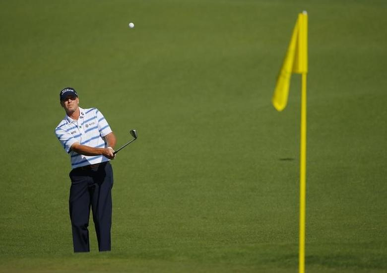U.S. golfer Steve Stricker hits a shot onto the second green during the first round of the 2014 Masters golf tournament at the Augusta National Golf Club in Augusta, Georgia April 10, 2014. REUTERS/Brian Snyder