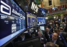 Traders gather at the booth that trades Abbott Laboratories on the floor of the New York Stock Exchange, December 10, 2012.   REUTERS/Brendan McDermid