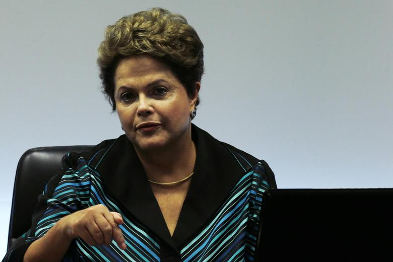 Brazil's President Dilma Rousseff reacts during a meeting with International Olympic Committee (IOC) President Thomas Bach (not pictured) at the Planalto Palace in Brasilia, July 11, 2014. REUTERS/Ueslei Marcelino