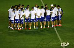 Argentina's national soccer team players listen to coach Alejandro Sabella (in white cap) during their training session in Rio de Janeiro July 12, 2014, ahead of their 2014 World Cup Final soccer match against Germany on July 13.    REUTERS/Darren Staples
