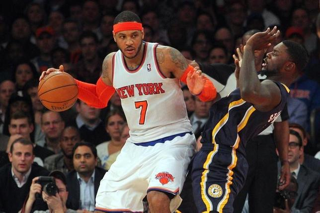 Mar 19, 2014; New York, NY, USA; New York Knicks small forward Carmelo Anthony (7) controls the ball against Indiana Pacers shooting guard Lance Stephenson (1) during the fourth quarter of a game at Madison Square Garden. The Knicks defeated the Pacers 92-86. Mandatory Credit: Brad Penner-USA TODAY Sports