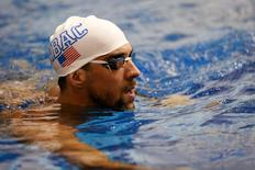 Jul 12, 2014; Athens, GA, USA; Michael Phelps warms prior to competitions in the Saturday finals of the Bulldog Grand Slam at Gabrielsen Natatorium. Mandatory Credit: Kevin Liles-USA TODAY Sports