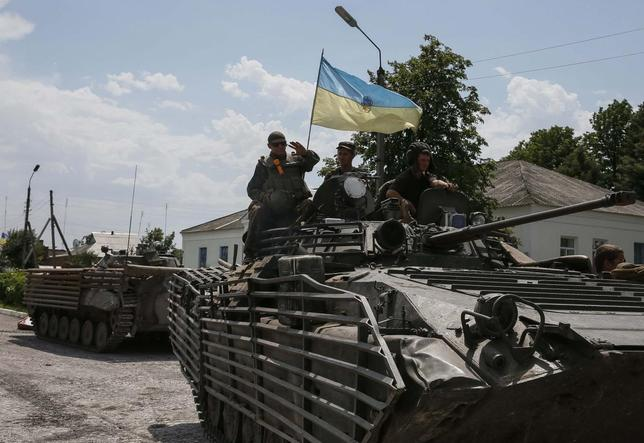 Ukrainian troops are pictured in the eastern Ukrainian town of Seversk July 12, 2014.  REUTERS/Gleb Garanich