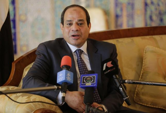 Egypt's President Abdel Fattah al-Sisi answers a question from the media upon his arrival at Algiers airport June 25, 2014. REUTERS/Louafi Larbi