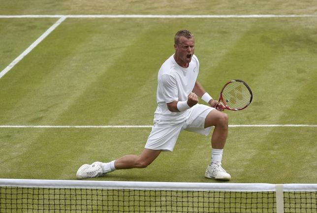 Lleyton Hewitt of Australia celebrates winning the fourth set during his men's singles match against Jerzy Janowicz of Poland at the Wimbledon Tennis Championships, in London June 27, 2014. REUTERS/Toby Melville