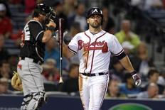 Apr 22, 2014; Atlanta, GA, USA; Atlanta Braves second baseman Dan Uggla (26) reacts after striking out against the Miami Marlins in the fifth inning at Turner Field. Mandatory Credit: Brett Davis-USA TODAY Sports