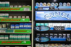 Newport and Camel cigarettes are stacked on a shelf inside a tobacco store in New York July 11, 2014.  REUTERS/Lucas Jackson