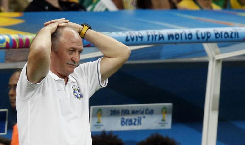 Brazil's coach Luiz Felipe Scolari reacts as his team plays against the Netherlands during their 2014 World Cup third-place playoff at the Brasilia national stadium in Brasilia in this July 12, 2014 file photo. REUTERS/Ueslei Marcelino/Files