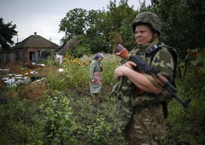 Ukraine says Russian army officers fighting alongside...