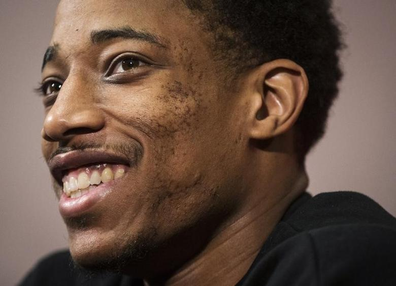 NBA basketball player DeMar DeRozan walks speaks at the Toronto Raptors season-end media availability in Toronto, May 5, 2014.   REUTERS/Mark Blinch
