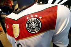 A memorabilia jersey of German national soccer team showing four stars, symbolizing the number of reached World Cup championships, is seen at an Adidas retailer in Frankfurt July 14, 2014. REUTERS/Ralph Orlowski