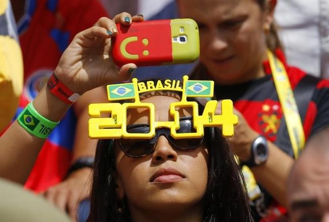 A fan records on her mobile phone before the 2014 World Cup Group D soccer match between Italy and Costa Rica at the Pernambuco arena in Recife June 20, 2014. REUTERS/Brian Snyder/Files