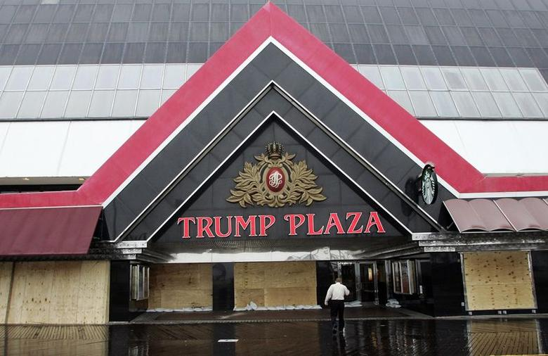 A security guard walks towards the entrance of the Trump Plaza as Hurricane Sandy approaches in this file photo taken October 28, 2012. The Trump Plaza could shut its doors in September and lay off 1,000 workers, a local newspaper reported, in what could make it the fourth casino to close this year in the faltering New Jersey resort city.  REUTERS/Tom Mihalek/Files  (UNITED STATES - Tags: ENVIRONMENT BUSINESS)