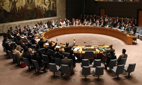 The United Nations Security Council unanimously votes on a resolution authorizing humanitarian aid access into rebel-held areas of Syria, during a United Nations Security Council meeting at U.N. headquarters in New York July 14, 2014. REUTERS/Mike Segar