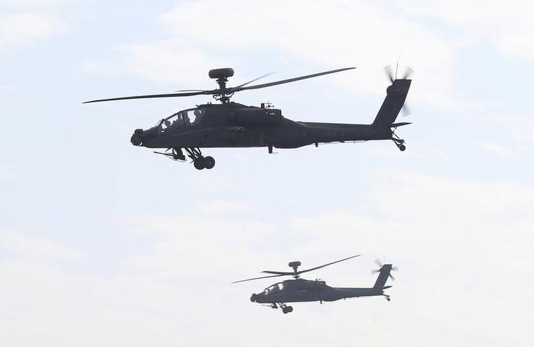 AH-64E Apache attack helicopters which are equipped with AN/APG-78 Longbow Fire Control Radar and purchased from the U.S. take part during a commissioning ceremony at the Tainan military base in Tainan, southern Taiwan December 13, 2013. REUTERS/Stringer