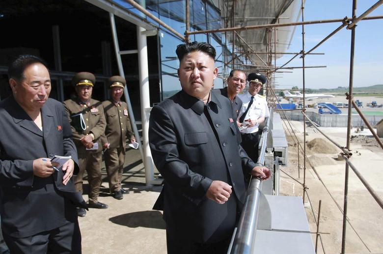 North Korean leader Kim Jong Un pays a visit to the construction site of a terminal at Pyongyang International Airport in this undated photo released by North Korea's Korean Central News Agency (KCNA) in Pyongyang on July 11, 2014. REUTERS/KCNA