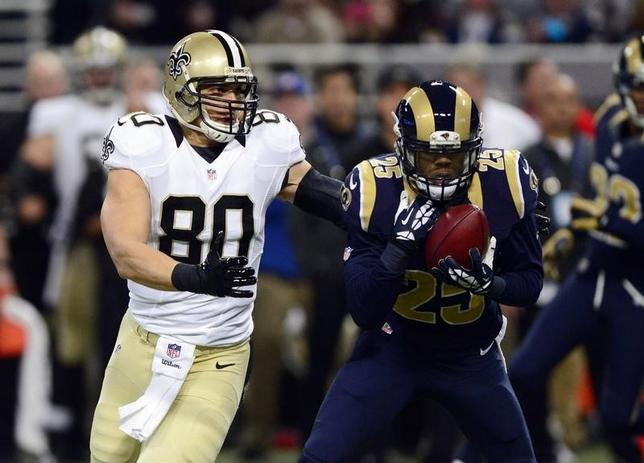 St. Louis Rams strong safety T.J. McDonald (25) intercepts a pass intended for New Orleans Saints tight end Jimmy Graham (80) during the first half at the Edward Jones Dome. Dec 15, 2013; St. Louis, MO, USA; Jeff Curry-USA TODAY Sports