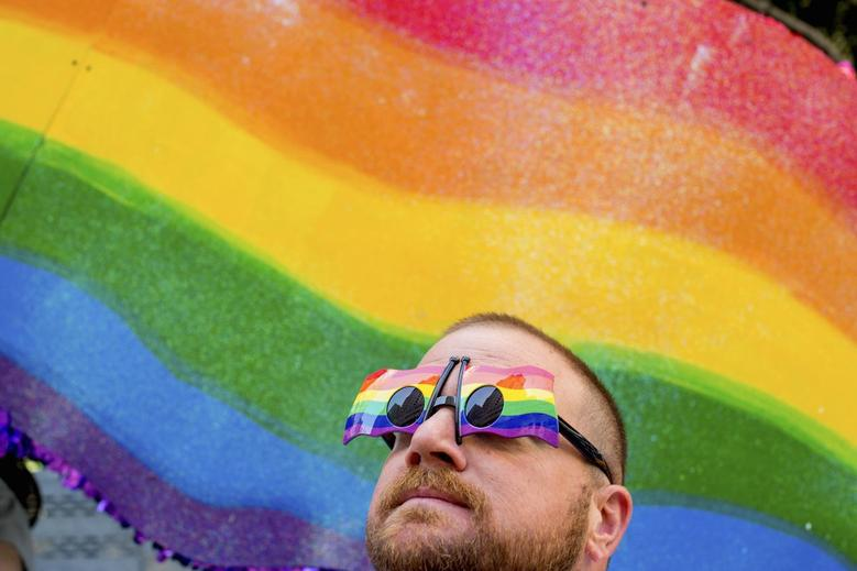 John Lucas stands in front of a rainbow flag at the San Francisco Gay Pride Festival in California June 29, 2014.    REUTERS/Noah Berger