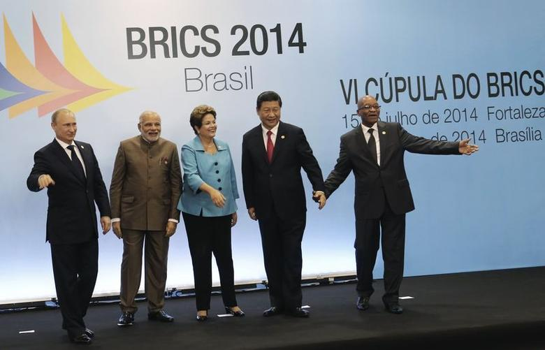 (L-R) Russian President Vladimir Putin, Indian Prime Minister Narendra Modi, Brazilian President Dilma Rousseff, Chinese President Xi Jinping and South African President Jacob Zuma smile at a group photo session during the 6th BRICS summit in Fortaleza July 15, 2014. REUTERS/Nacho Doce