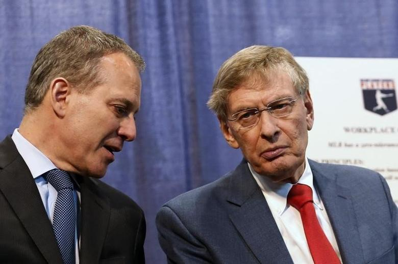 New York Attorney General Eric Schneiderman (L) and Major League Baseball Commissioner Bud Selig attend a news conference about MLB's policies against harassment and discrimination based on sexual orientation in New York, July 16, 2013. REUTERS/Brendan McDermid
