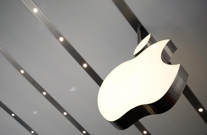 The Apple logo is pictured inside the newly opened Omotesando Apple store at a shopping district in Tokyo June 26, 2014.  REUTERS/Yuya Shino