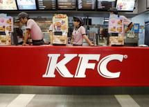KFC's staff wait for customers at its restaurant in Beijing October 9, 2013. REUTERS/Kim Kyung-Hoon