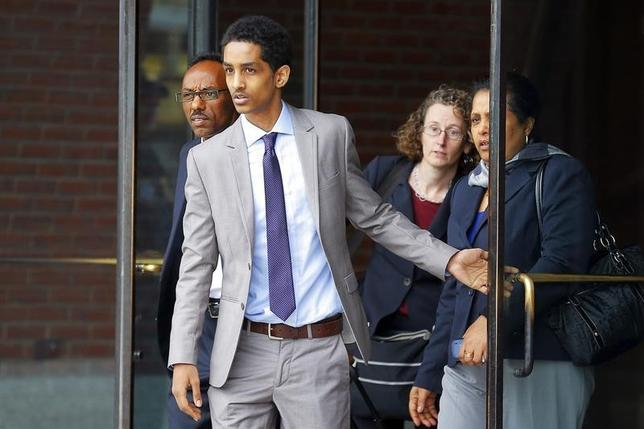 Robel Phillipos (2nd L), a friend of suspected Boston Marathon bomber Dzhokhar Tsarnaev, who is charged with lying to investigators, leaves the federal courthouse after a hearing in his case in Boston, Massachusetts May 13, 2014.    REUTERS/Brian Snyder